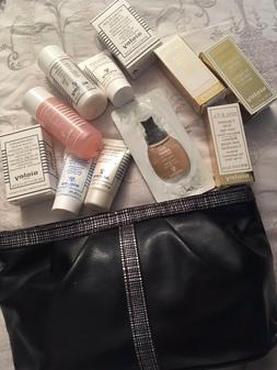4QW make-up bag full of 11 x sisley luxury items mixed bundl
